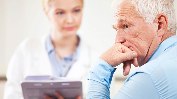 Elderly male with concerned look at doctor's office