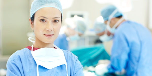 Female          Asian surgeon in operating room
