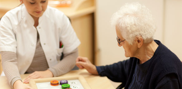 Female doctor conducting memory test on elderly female patient