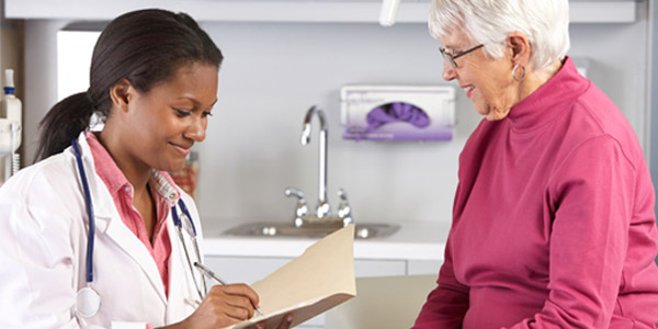 Female                doctor examining senior female patient