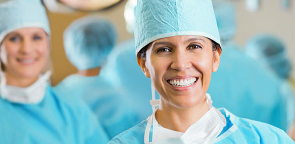 Female Hispanic surgeon in operating room