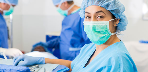 Hispanic female surgeon preparing for surgery