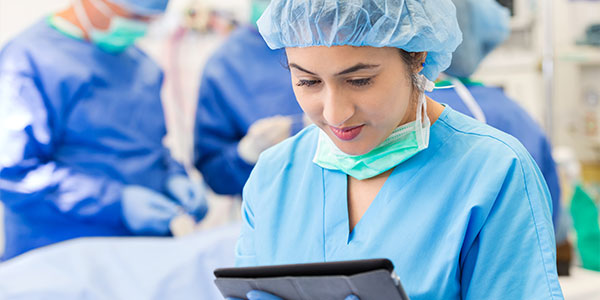 Surgical nurse with tablet