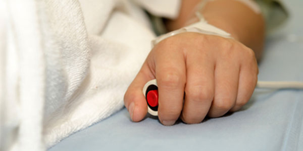 Patient holding nurse call button