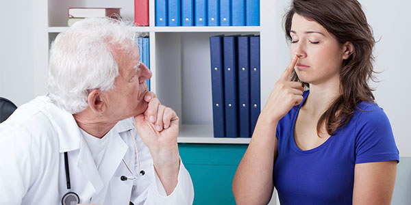 Physician giving neuro exam to female patient