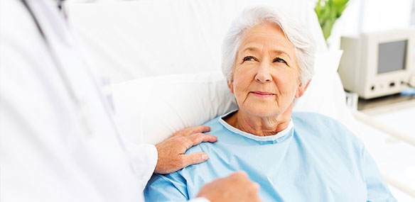 Senior woman in hospital bed with concerned look