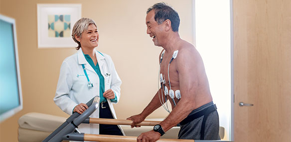 Sutter doctor with patient on treadmill