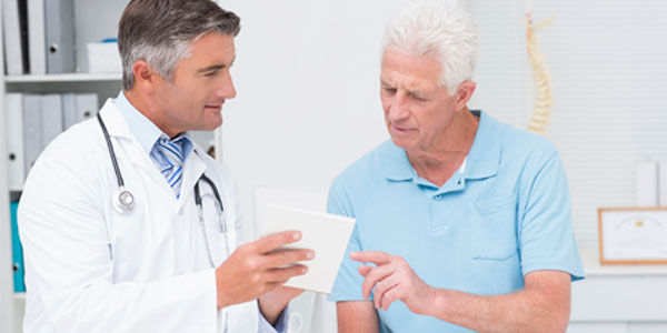 Male doctor and patient in discussion