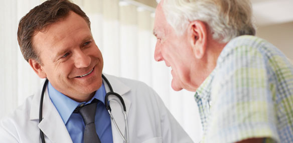 Doctor in discussion with elderly male