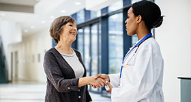 Woman and doctor handshake