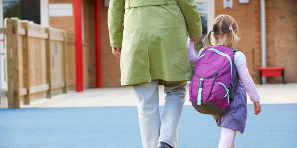 Parent walking Child To Pre School