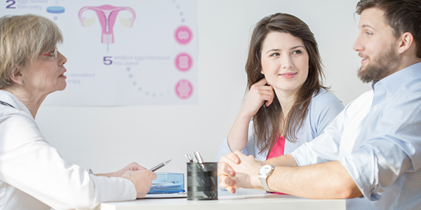 young couple at fertility office