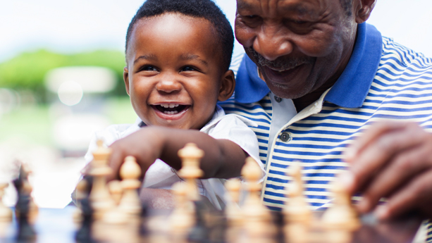 Grandpa and grandson playing chess
