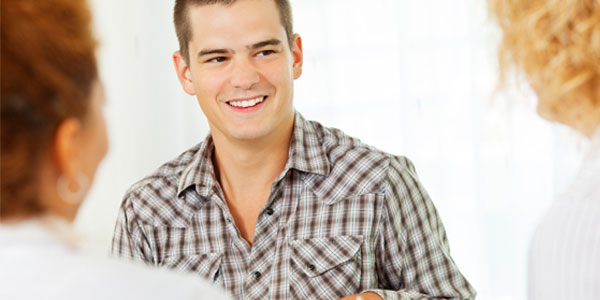 Young man in discussion at support group