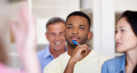 Young African-American man listening to instructor