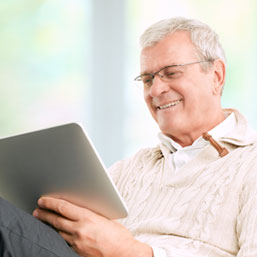 Elderly white man viewing digital tablet