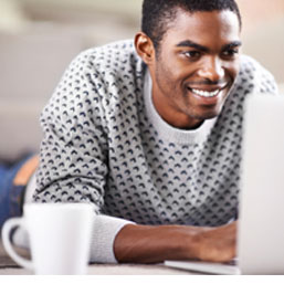 Young African-American man using a laptop
