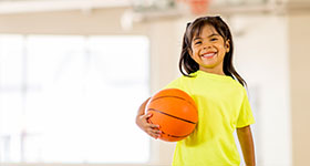 Hispanic girl playing basketball