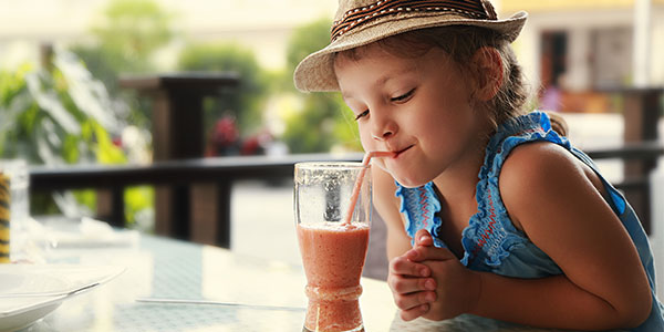Little girl drinking smoothie