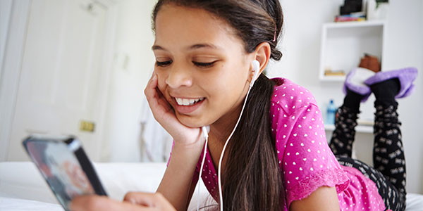 Preteen listening to music