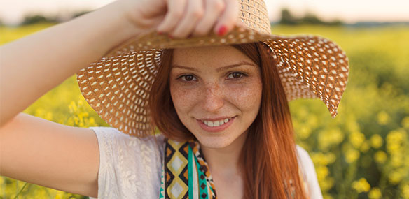 Teen girl with freckles and red hair