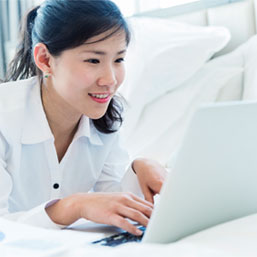 Young Asian woman on laptop
