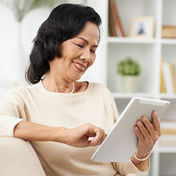 Asian woman using digital tablet