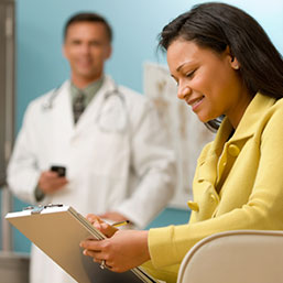 Female patient filling out medical forms