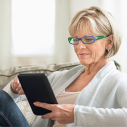 Mature woman on digital tablet