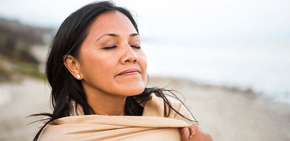 Peaceful woman at beach