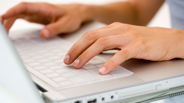 white-female-hands-on-laptop-614x346
