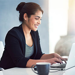 Woman smiling on laptop