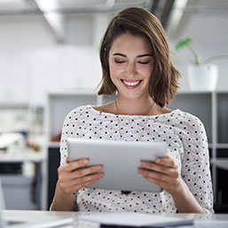 Woman using tablet at work