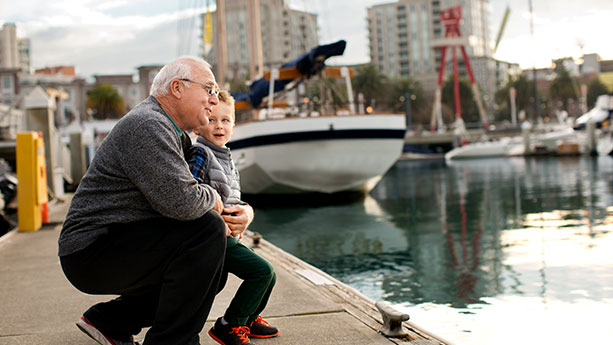 Boy and gandfather at marina