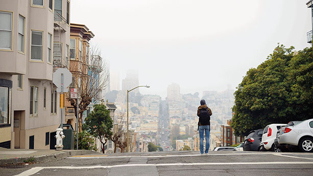 Man walking down foggy SF street