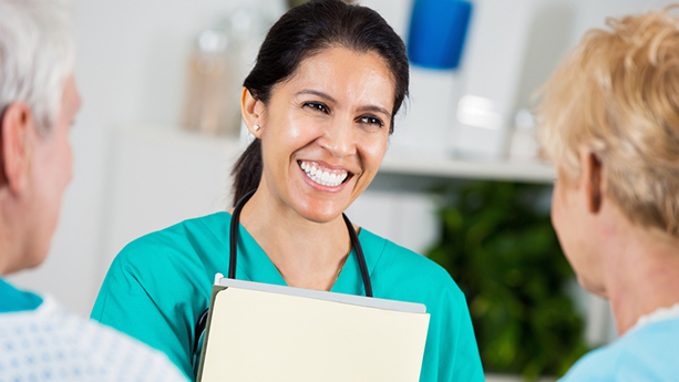 nurse smiling at patients