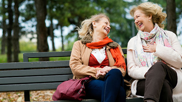 Two women laughing outside